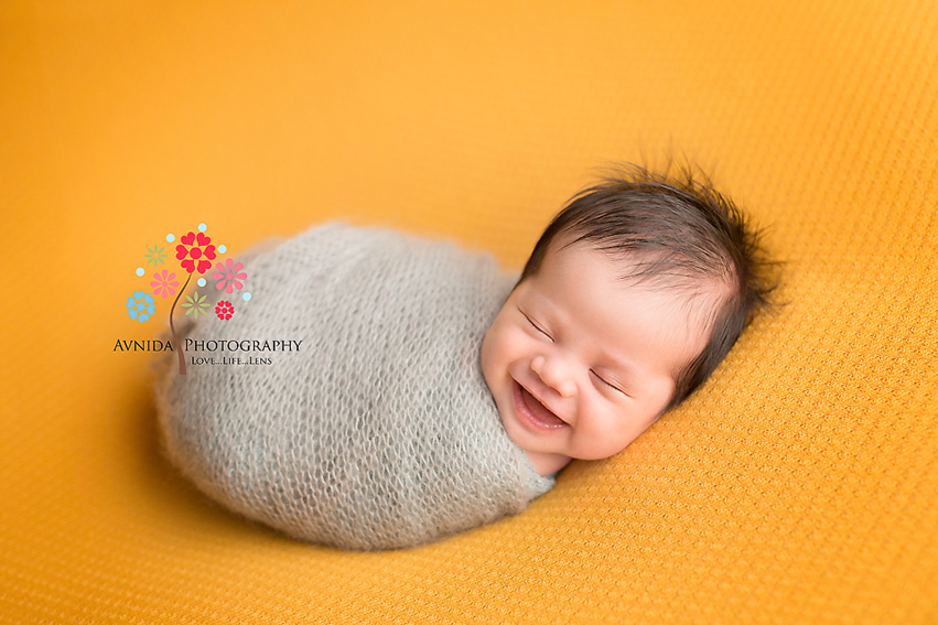 How to get a wrapped pose for newborn photography by Avnida Photography, the finest NJ Newborn Photographer