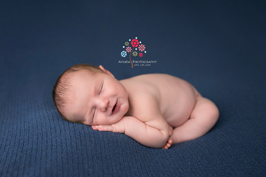 How to get this interesting variation of the taco pose for newborn photography by Avnida Photography, the finest NJ Newborn Photographer