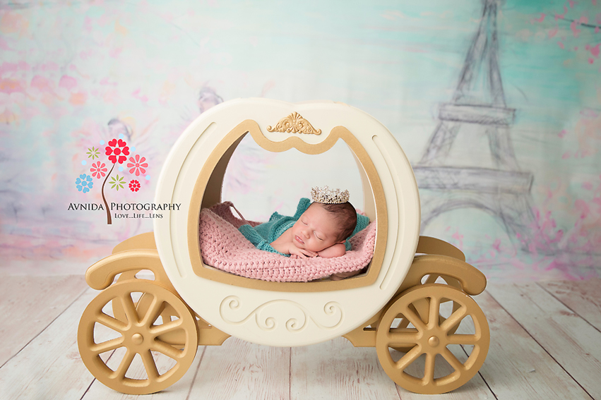 Tips for posing a newborn with a princess carriage prop by newborn photographer NJ
