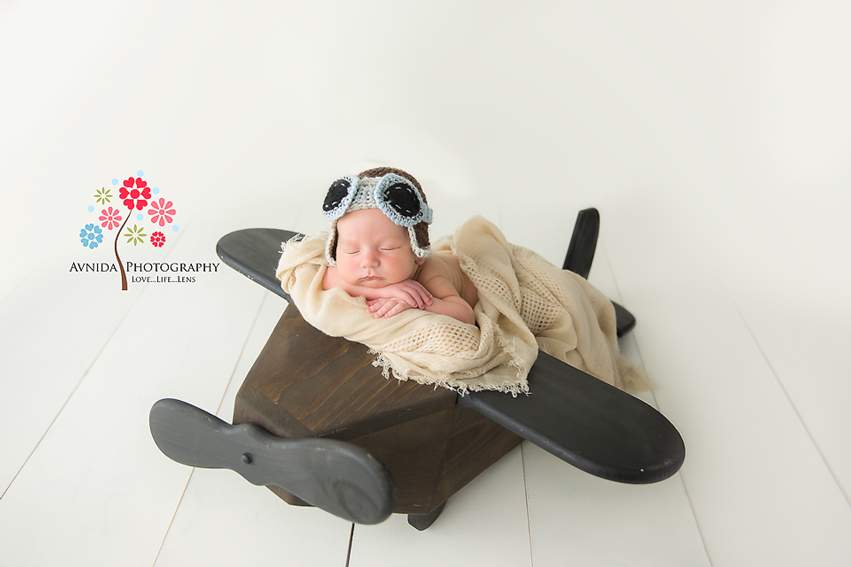 Tips for posing a newborn with an airplane prop by Newborn Photographer NJ