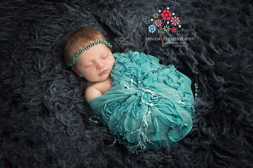 Tips for the best wrapped pose for newborn photography by Avnida Photography, the finest NJ Newborn Photographer