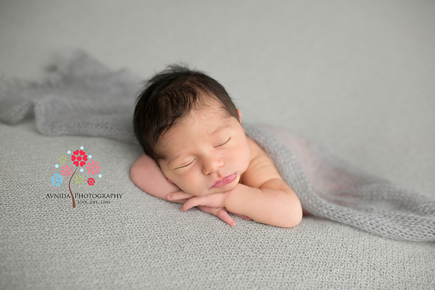 How to get a hands under the chin pose for newborn photography by Avnida Photography, the finest NJ newborn photographer